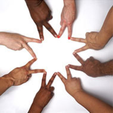 hands of different skin colors making peace signs and forming a circle