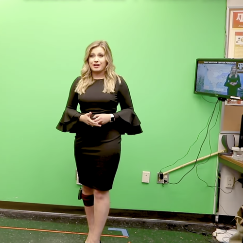 Mia Montgomery in front of the green screen