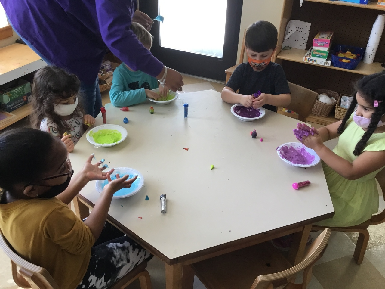 children painting in class room