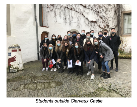 Students pose outside Clervaux Castle