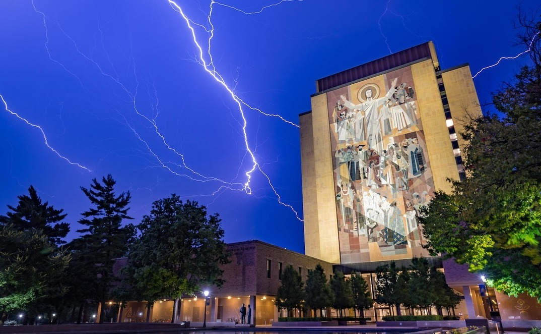 Lightning strikes in the sky above Hesburgh Library