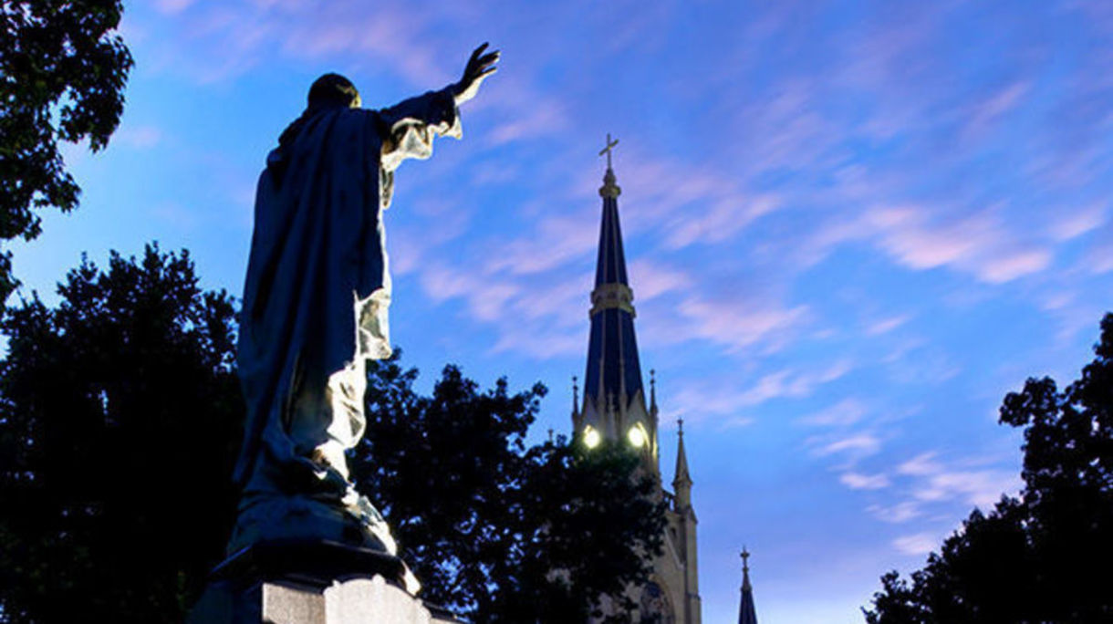 Jesus statue and the Basilica at the University of Notre Dame