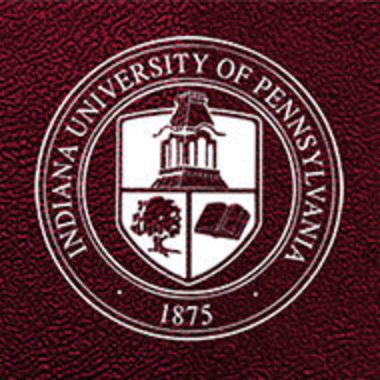 IUP seal in white on brown leather-looking background