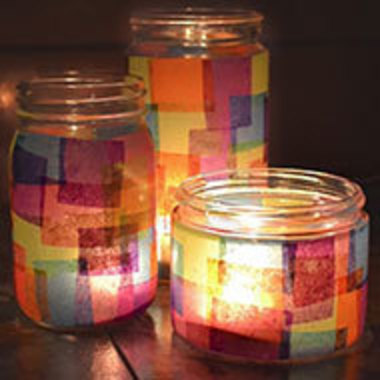 three different-sized jars covered in tissue paper of different colors