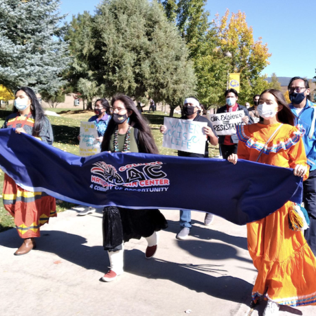 Students walking in Indigenous Peoples Day march