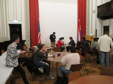 Students await the results of the chess tournament in the Great Hall