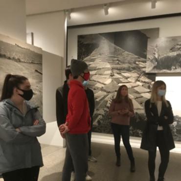 Students tour the Family of Man exhibit