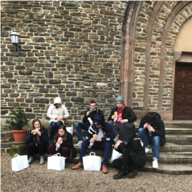 Students on steps of Abbey with gift bags