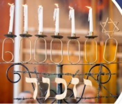Candles with number 6,000,000 and hebrew word for