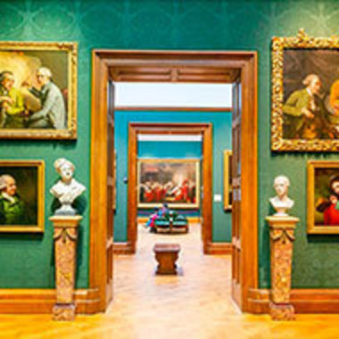 museum interior with sculptures and paintings on display