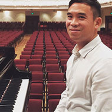 Henry Wong Doe at the piano in an empty performance hall