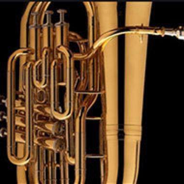closeup of tuba on black background