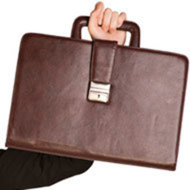closeup of hand holding up a small briefcase