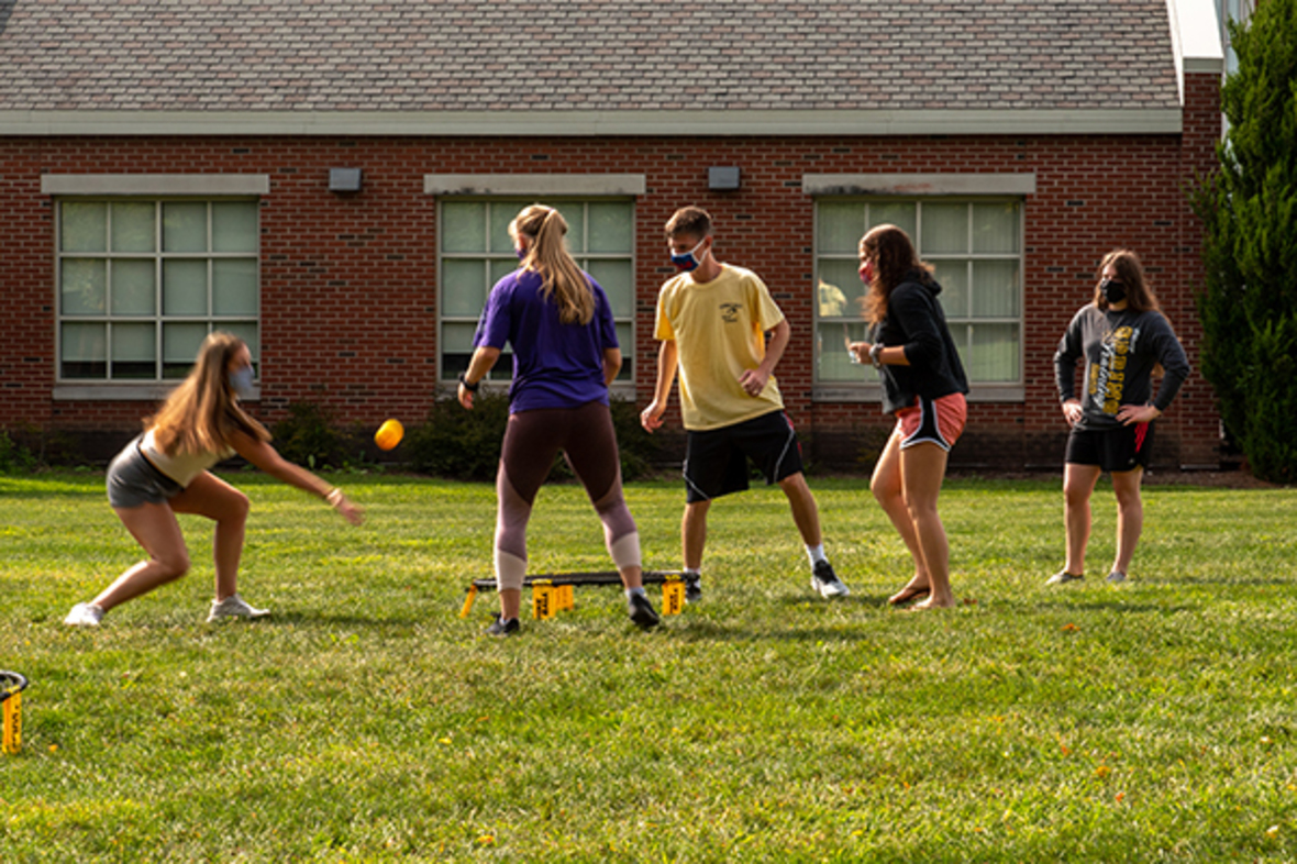 Students playing Spikeball in Clock Tower quad