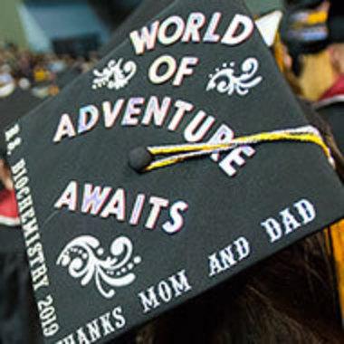 top of graduation cap that reads