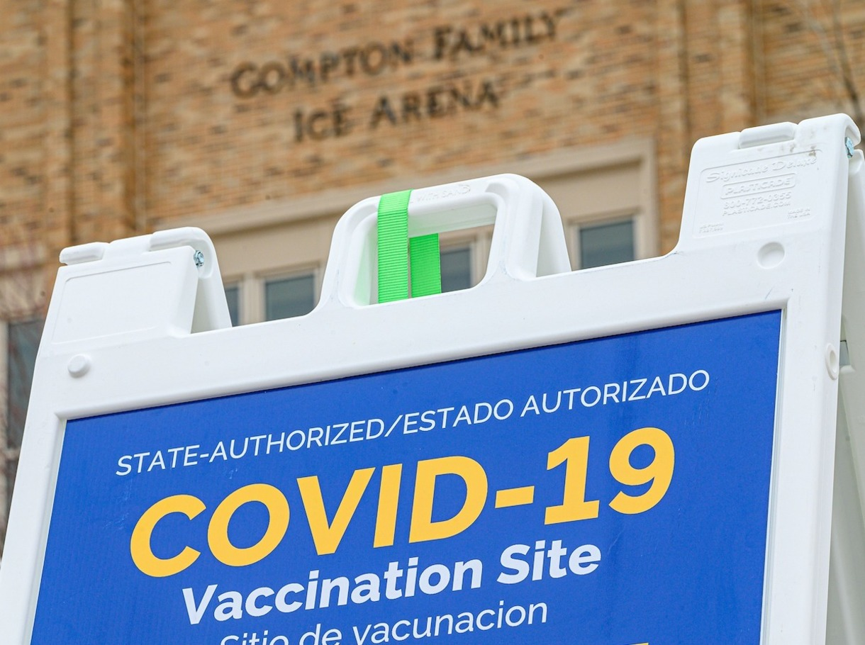 Sandwich-board sign outside the Compton Family Ice Arena that says COVID-19 vaccination site