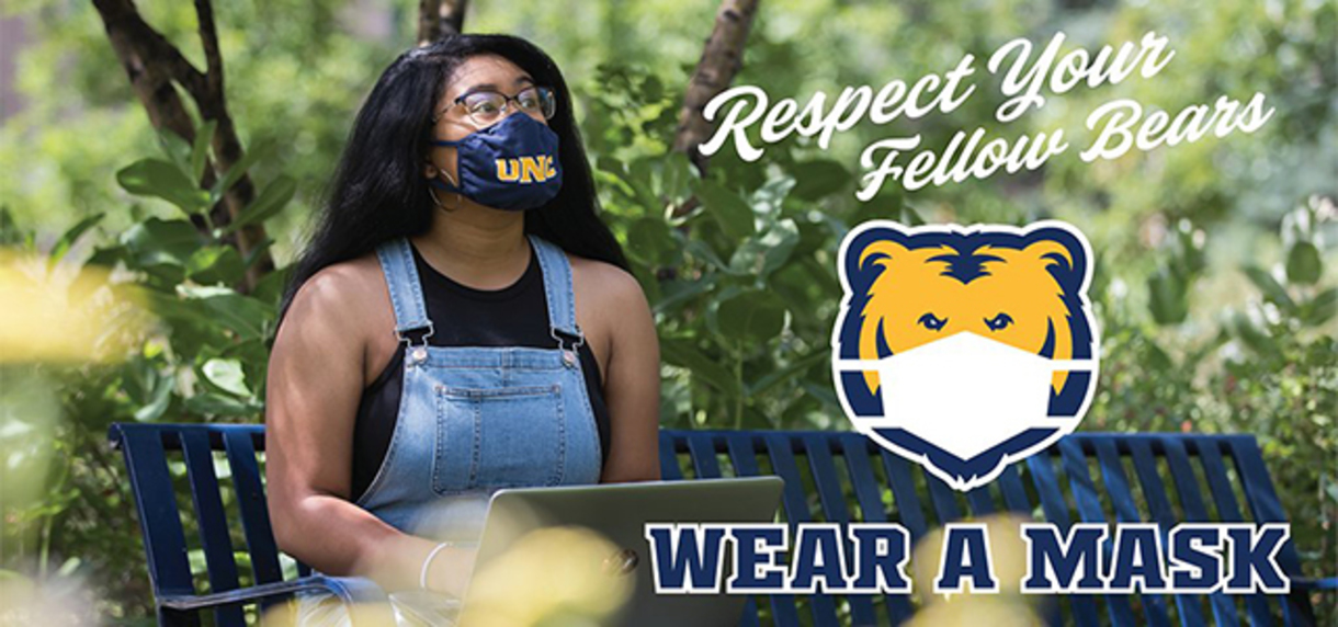 Student wearing a mask while on campus