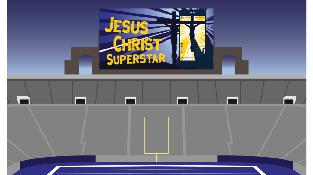 Notre Dame Stadium with graphic for Jesus Christ Superstar on the big screen.