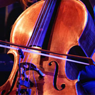 closeup of a cello being played