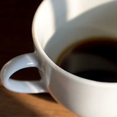 closeup of a half-full coffee cup