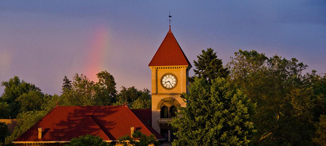 Photo of Memorial Building clocktower under a rainbow