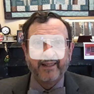 computer video still of IUP President Michael Driscoll in his office giving one of his updates