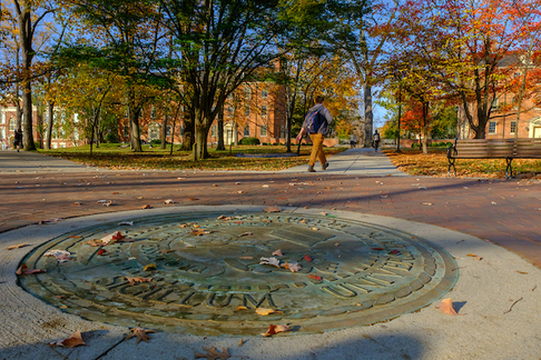 Student walks past the Miami Seal on a sunny fall afternoon.