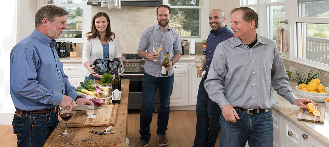 The deLeuze family cooking in the Carneros kitchen