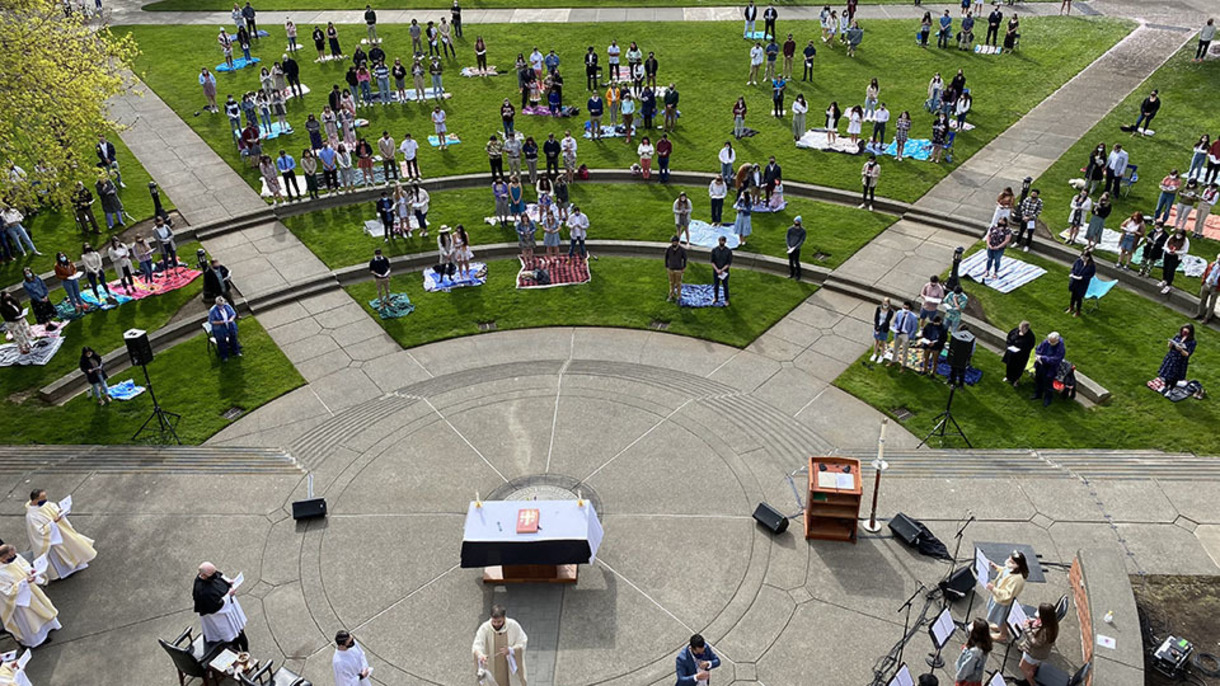 Hundreds gather on the Academic Quad in physically distanced groups to celebrate Easter Mass.