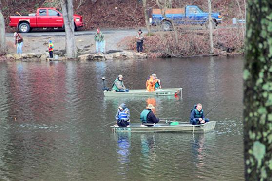 People, water, lake, boats, fishing, life jackets