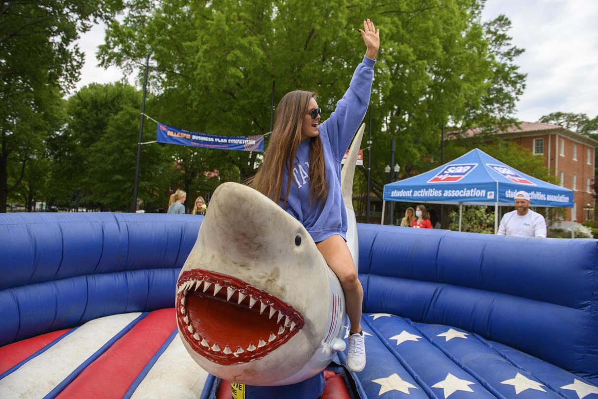 Student riding mechanical shark