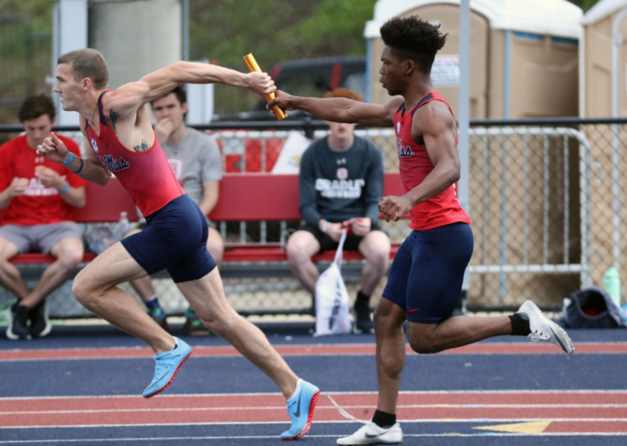 Ole Miss Track and Field in the Joe Walker Invite at the Ole Miss Track & Field Complex in Oxford, MS, on Sunday, April 11, 2021 - student passing baton