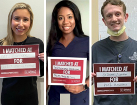 Students holding match day signs