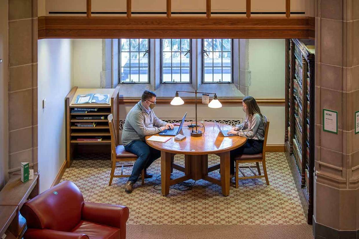 Law School students Alex Maurer and Bridget McConville work in the Kresge Law Library.