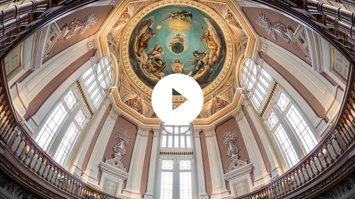 A photo of the rotunda ceiling and a play button.