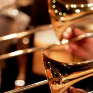 closeup of trombones in concert