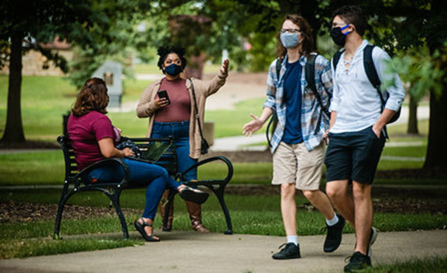 two pairs of students having conversations in IUP's Oak Grove