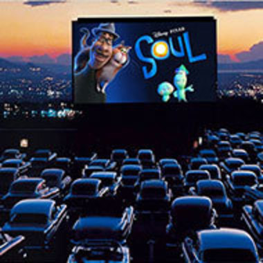 cars parked at a drive-in theater with