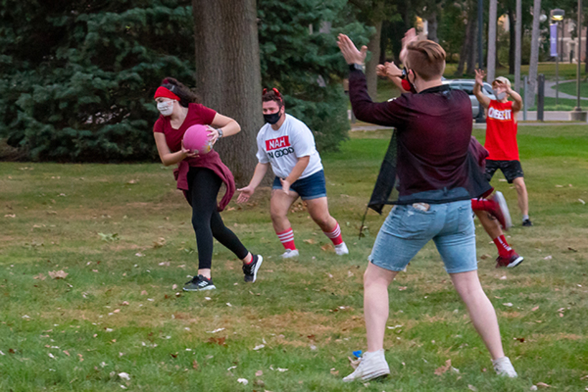 Students playing kickball