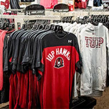 racks of IUP apparel in the IUP Co-op Store