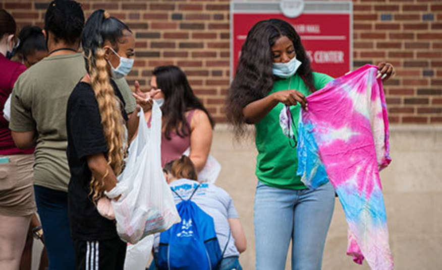 students tie dyeing clothing during Welcome Week