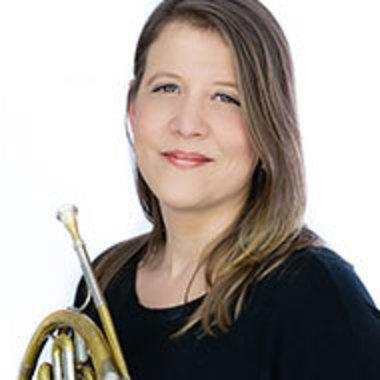 portrait of Heidi Lucas holding her horn