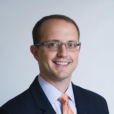 Dr. Travis Baggett