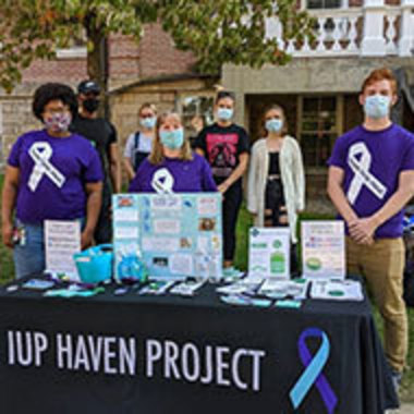Haven Project workers providing information at a table outside Sutton Hall