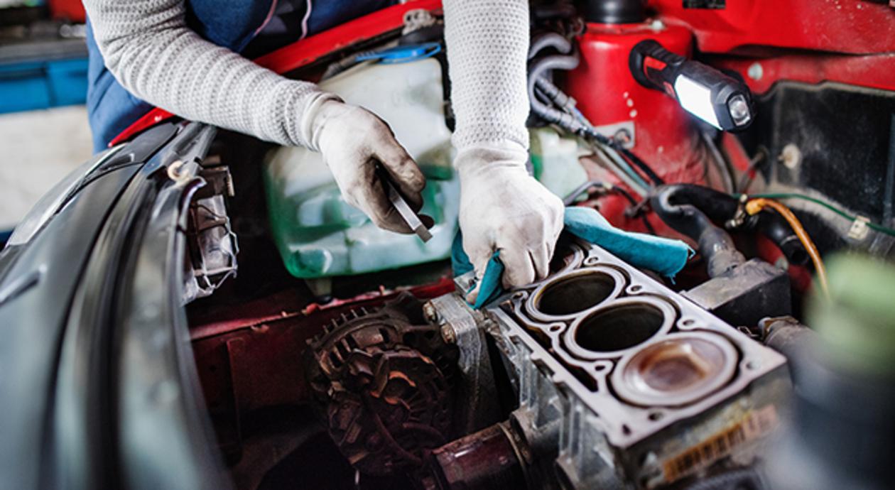 Automotive Tech working on an engine
