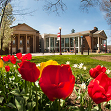 Fisher Auditorium and Waller Hall with spring tulips in the foreground