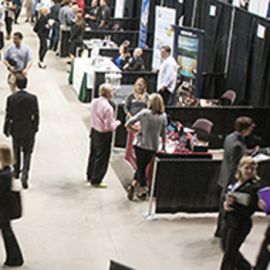 People walking through a career fair