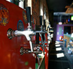 A wall full of craft beer taps waiting to quench your thirst