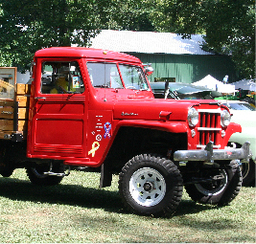 A cool vintage cherry red pickup truck