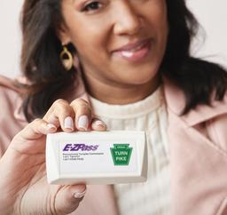 Woman holding up an E-Z Pass